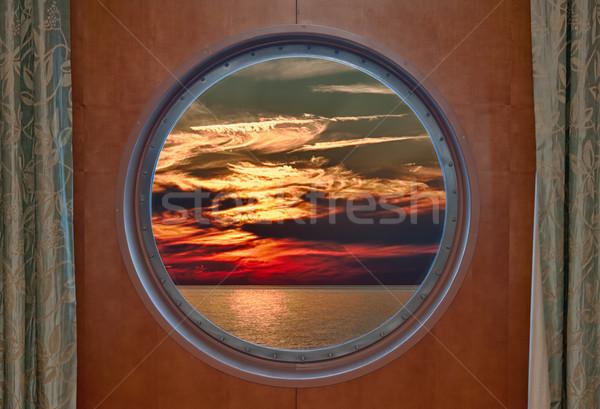 Dramatic Sunset Seen Through a Ship Porthole Stock photo © sbonk