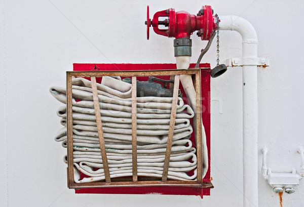 Fire Hose on Wall Stock photo © sbonk
