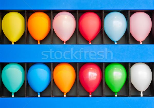 Geval ballonnen Blauw muur kleurrijk foto Stockfoto © sbonk