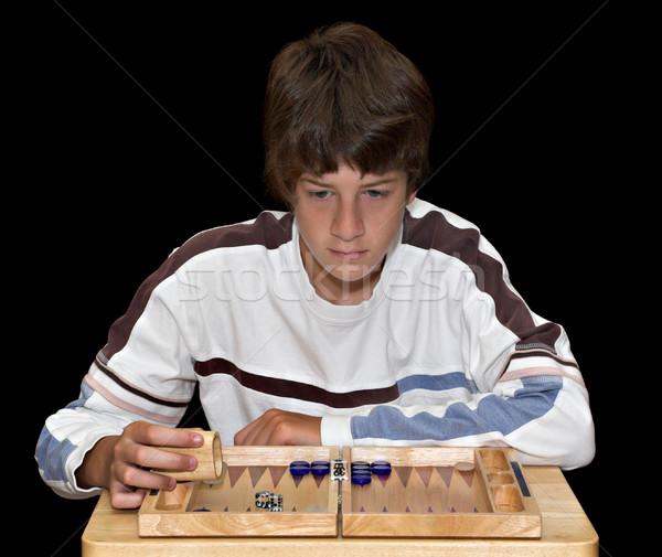 Jongen spelen jonge spel boord Stockfoto © sbonk