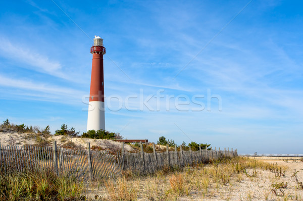 Deniz feneri plaj eski ahşap çit manzara Stok fotoğraf © sbonk