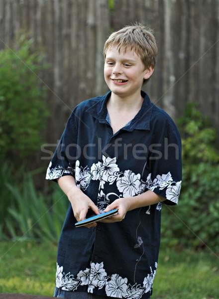Młody chłopak gry tenis stołowy uśmiechnięty na zewnątrz dzieci Zdjęcia stock © sbonk