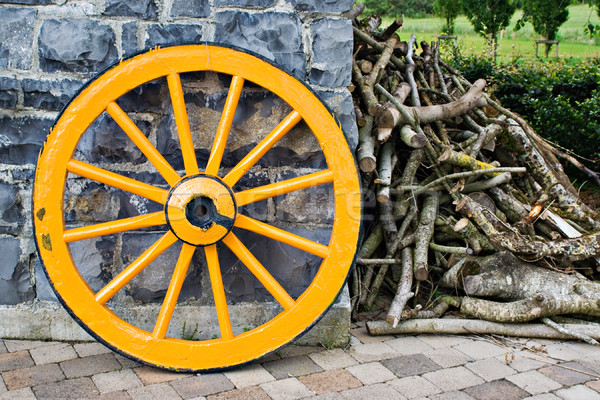 Wooden Wagon Wheel and Branches Stock photo © sbonk