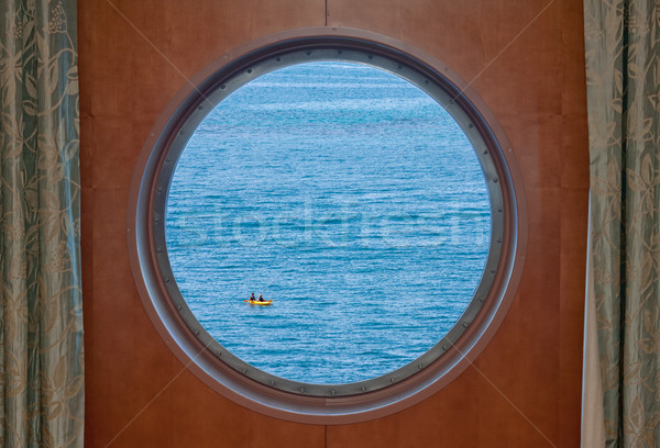 Ocean Kayak Seen Through Cruise Ship Porthole Stock photo © sbonk