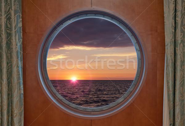 Sunrise Through porthole Stock photo © sbonk