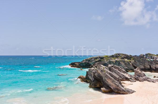 Strand hoefijzer hemel water wolken oceaan Stockfoto © sbonk