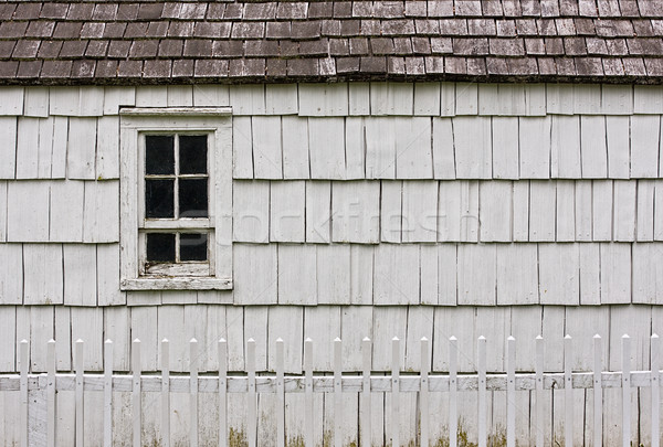 Old withe building and white picket fence Stock photo © sbonk