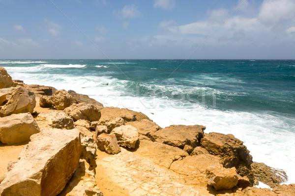 Ruig kalksteen kustlijn half maan wolken Stockfoto © scheriton