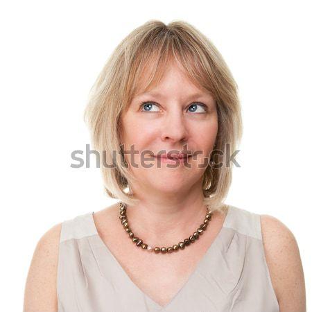 Attractive Woman Looking Upwards Stock photo © scheriton