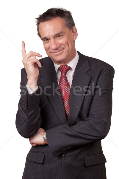 Smiling Business Man in Suit Pointing Up Stock photo © scheriton