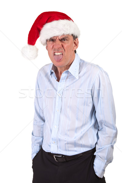 Grumpy Scrooge Business Man in Santa Hat sticking out tongue Stock photo © scheriton