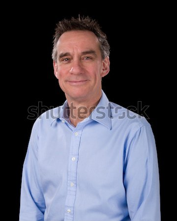 Man Pulling Silly Face Grinning on Grey Background Stock photo © scheriton
