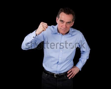 Mérges középső kor üzletember ököl fekete Stock fotó © scheriton