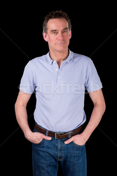 Happy Smiling Man with Hands in Pockets Relaxed Stock photo © scheriton