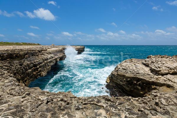 Kalksteen kustlijn brug wolken gras natuur Stockfoto © scheriton