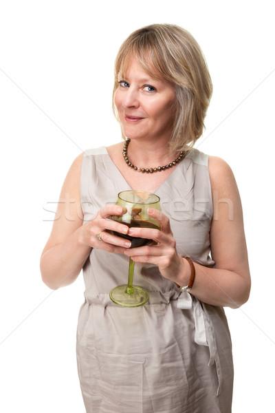 Mosolygó nő tart borospohár vonzó mosolyog érett nő Stock fotó © scheriton