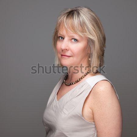 Portré vonzó nő intenzív néz vonzó érett nő Stock fotó © scheriton