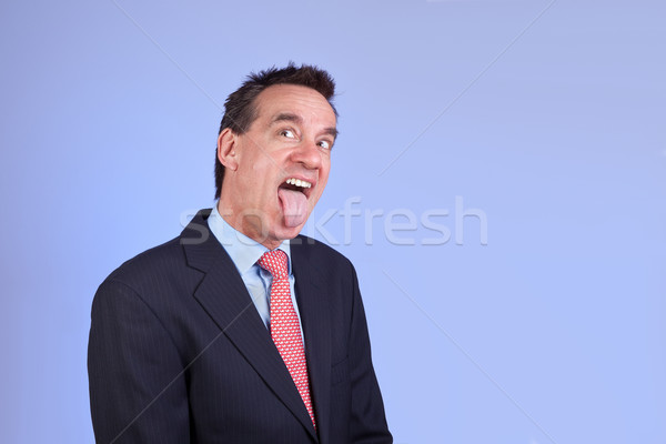 Business Man in Suit Sticking Out Tongue Stock photo © scheriton