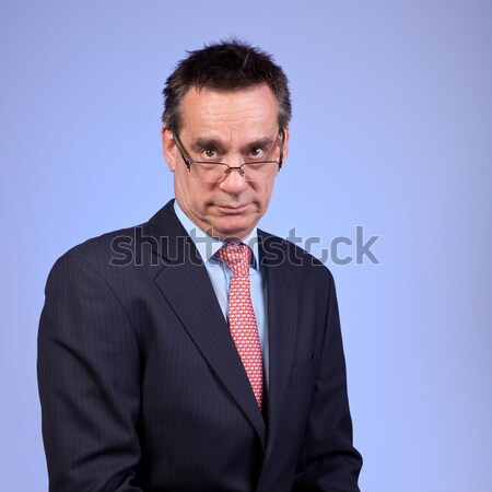 Grumpy Frowning Business Man in Suit Looking Over Glasses Stock photo © scheriton