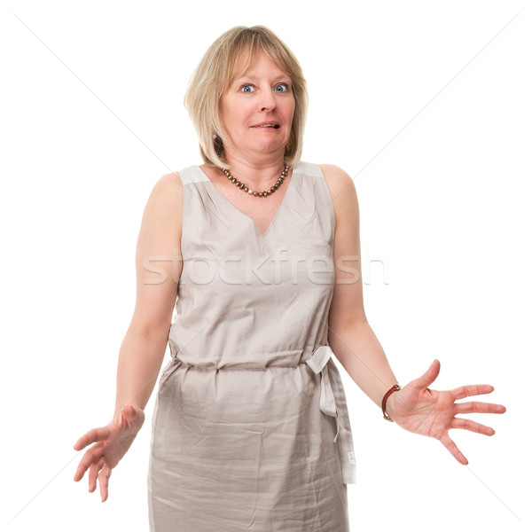 Woman with Scared Expression Holding Out Hands Stock photo © scheriton