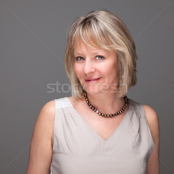Portré elegáns érett nő vonzó mosolyog szürke Stock fotó © scheriton