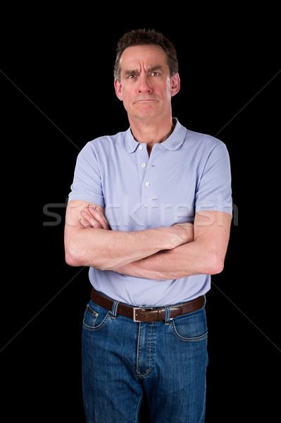 Zangado ranzinza meio idade homem brasão Foto stock © scheriton