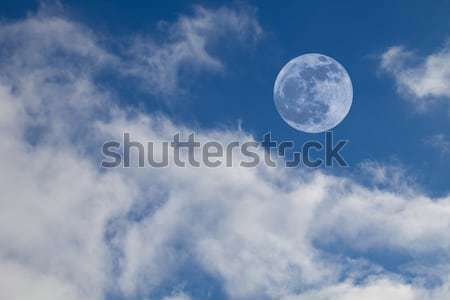 Full Moon on Blue Sky with Cumulus Clouds Stock photo © scheriton
