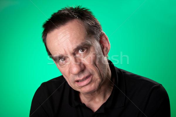 Férfi néz beteg boldogtalan zöld középső Stock fotó © scheriton