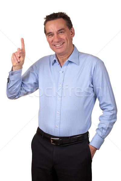 Sorridente homem de negócios indicação atraente para cima um Foto stock © scheriton