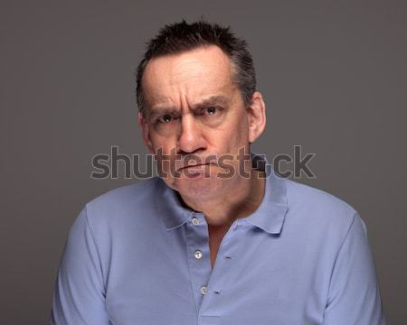 Man Pulling Grimace Face and Glaring Stock photo © scheriton