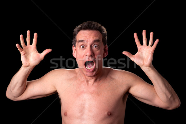 Shirtless Man Screaming Shouting in Horror on Black Background Stock photo © scheriton