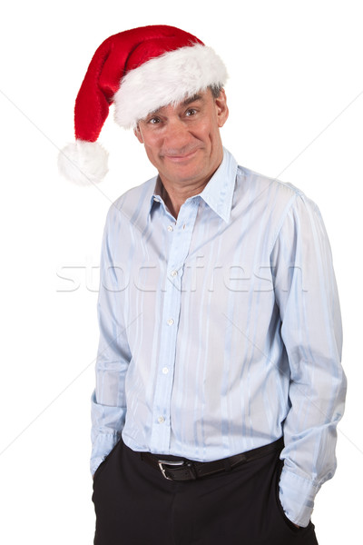 Stock photo: Grinning Business Man in Christmas Santa Hat