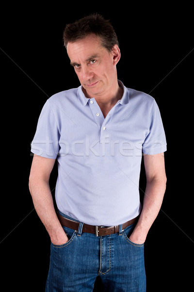 Grumpy Frowning Man with Hands in Pockets Stock photo © scheriton