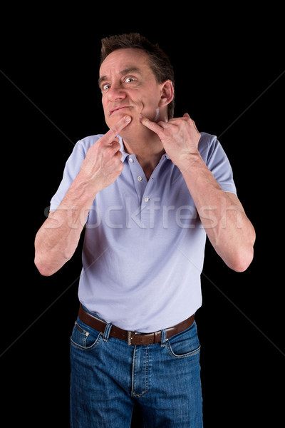 Funny Middle Age Man Squeezing Face Stock photo © scheriton