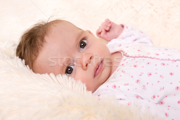 Beautiful Baby Girl resting on Cream Fur Rug Stock photo © scheriton