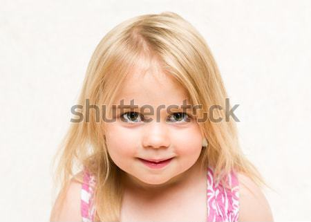 Portrait of beautiful blonde baby girl with cheeky grin Stock photo © scheriton