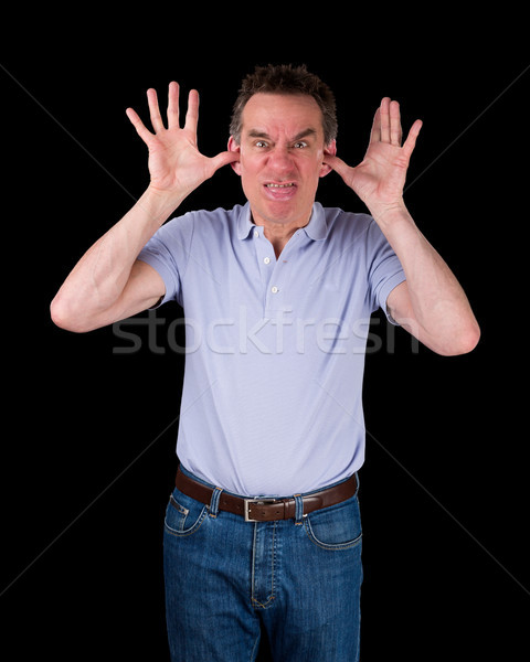 Angry Man Poking Out Tongue with Hands in Ears Stock photo © scheriton