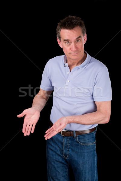 Homem bonito mãos indicação para baixo algo Foto stock © scheriton