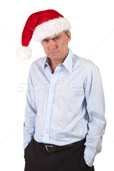 Grumpy Frowning Scrooge Business Man in Santa Hat Stock photo © scheriton