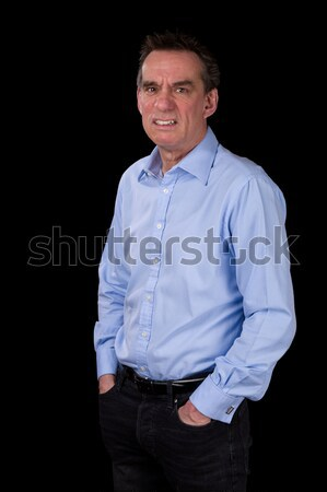 Angry Frowning Scowling Business Man Hands in Pockets Stock photo © scheriton