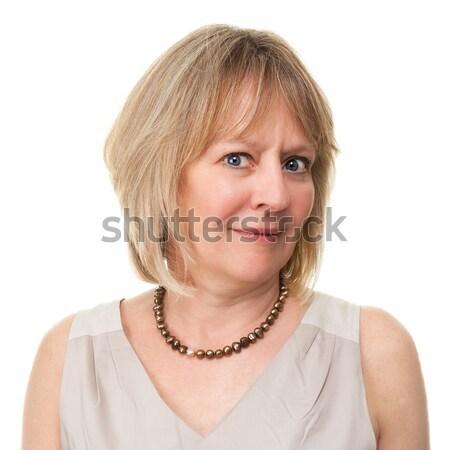 женщину недоуменный голову выстрел привлекательный Сток-фото © scheriton