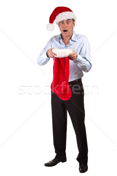 Business Man in Santa Hat shocked at contents of Christmas Stocking Stock photo © scheriton