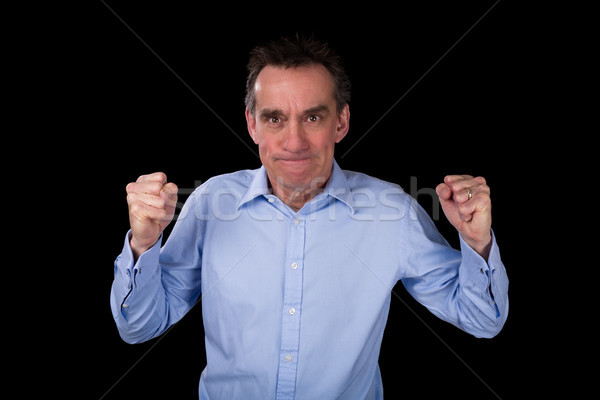 Angry Business Man Shaking Fists in Frustration Stock photo © scheriton
