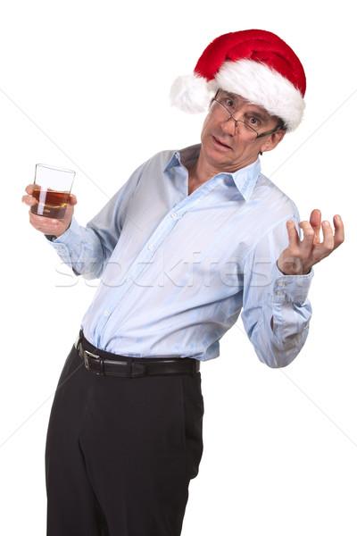 Drunk Business Man in Santa Hat holding Drink Stock photo © scheriton