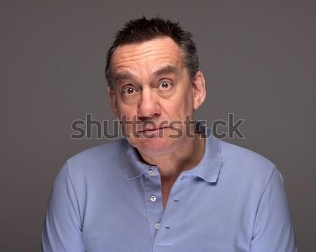 Férfi meglepődött szomorú szürke jóképű középső Stock fotó © scheriton
