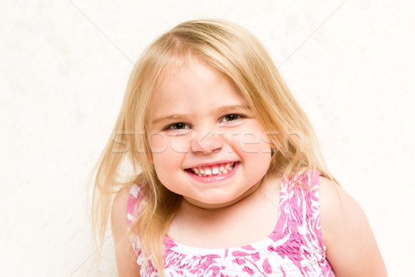 Closeup Portrait of Beautiful Toddler Girl Grinning Cheekily Stock photo © scheriton