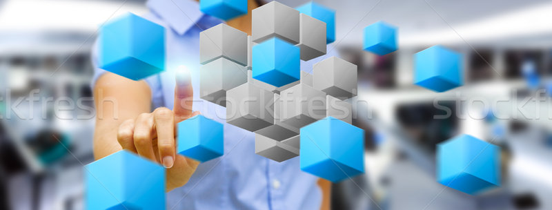 Businesswoman in his office using digital interface Stock photo © sdecoret