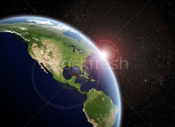 Nascer do sol planeta espaço ver sol pôr do sol Foto stock © sdecoret