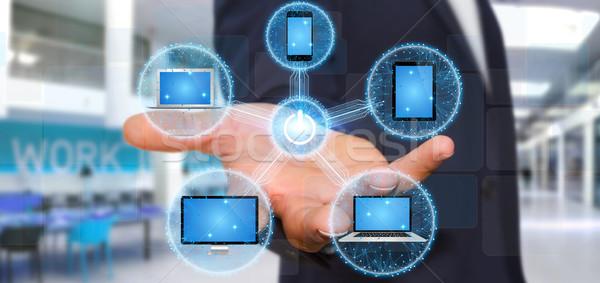 üzletember kapcsolódik tech berendezés ujj eszközök Stock fotó © sdecoret