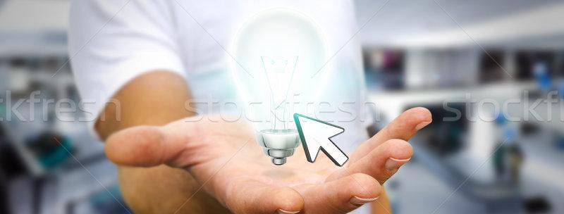 Businessman holding lightbulb Stock photo © sdecoret